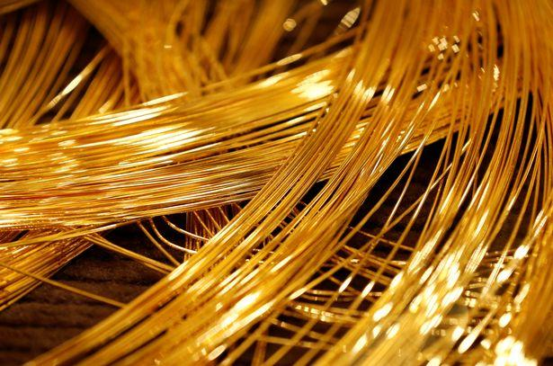 A close up view of a gold Christmas tree decorated with 19 kilograms 418 lbs of pure gold wires 2