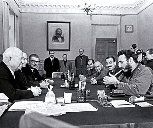 Fidel Castro lighting a cigar and wearing two Rolex watches during a meeting with Khrushchev Kremlin 1963small