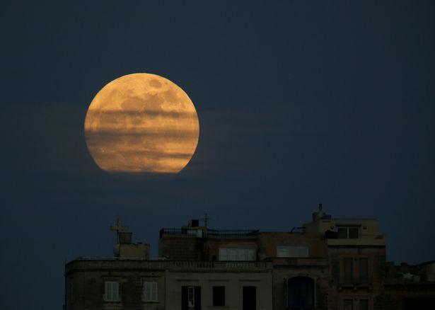 A supermoon full moon is seen rising in Pieta
